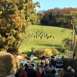 Silhouettes on the hill above the War Memorial in Stansted, Kent to celebrate the armistice centenary